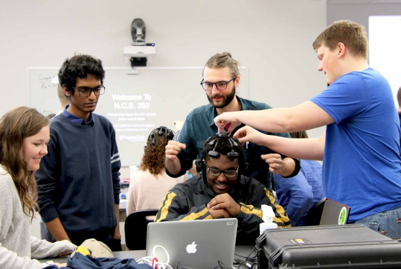 Matthew Emanuel is fitted with an EEG headset to play Pong,
